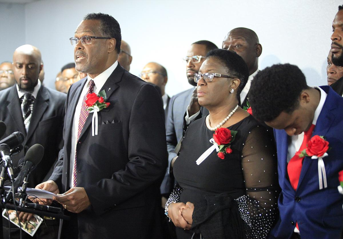 Sammie L. Berry speaks as church members stand with the family of Botham Shem Jean (September 13, 2018)