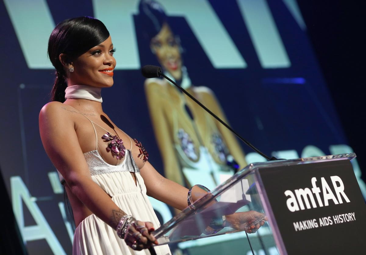 Rihanna speaks onstage during amfAR LA Inspiration Gala honoring Tom Ford at Milk Studios on October 29, 2014 in Hollywood, California