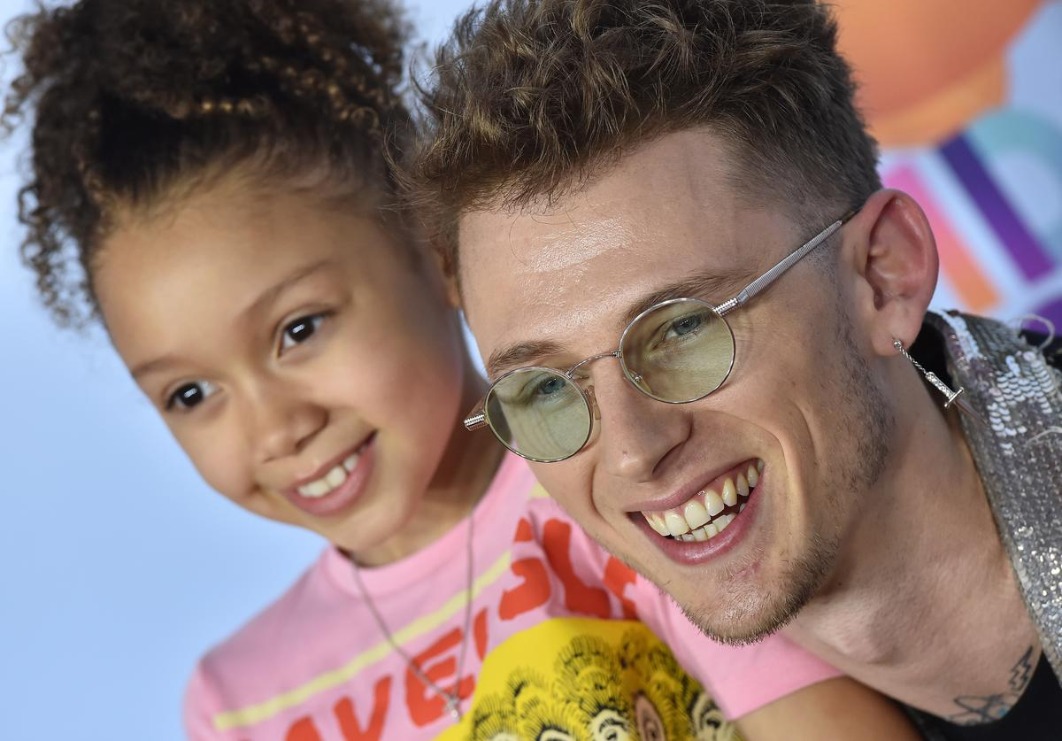 Machine Gun Kelly and daughter Casie Colson Baker arrive at Nickelodeon's 2017 Kids' Choice Awards at USC Galen Center on March 11, 2017 in Los Angeles, California