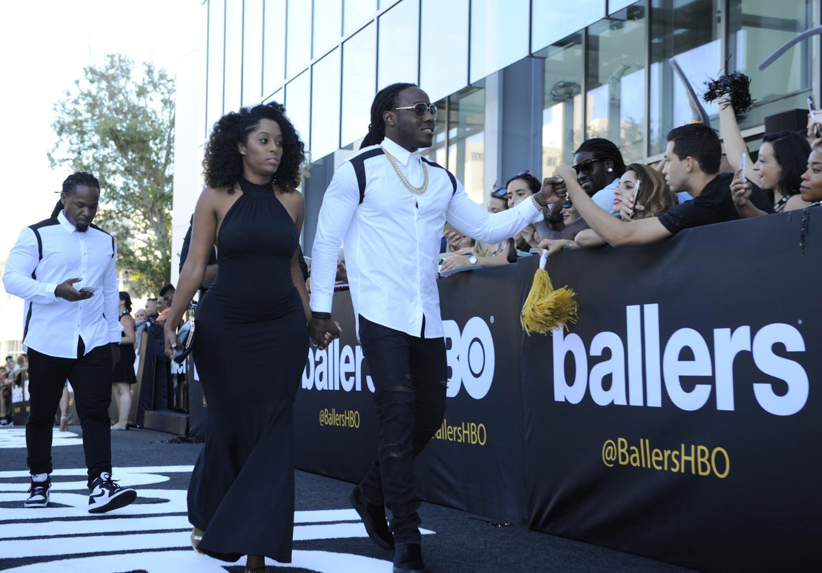 Shelah Marie and Rapper Ace Hood attend the HBO Ballers Season 2 Red Carpet Premiere
