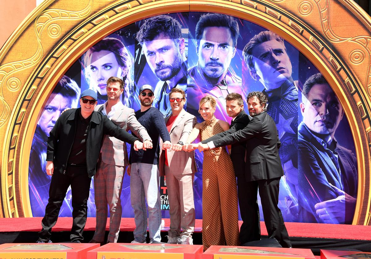 President of Marvel Studios/Producer Kevin Feige, Chris Hemsworth, Chris Evans, Robert Downey Jr., Scarlett Johansson, Jeremy Renner, and Mark Ruffalo poses at the Marvel Studios' 'Avengers: Endgame' Cast Place Their Hand Prints In Cement At TCL Chinese Theatre IMAX Forecourt at TCL Chinese Theatre IMAX on April 23, 2019 in Hollywood, California.