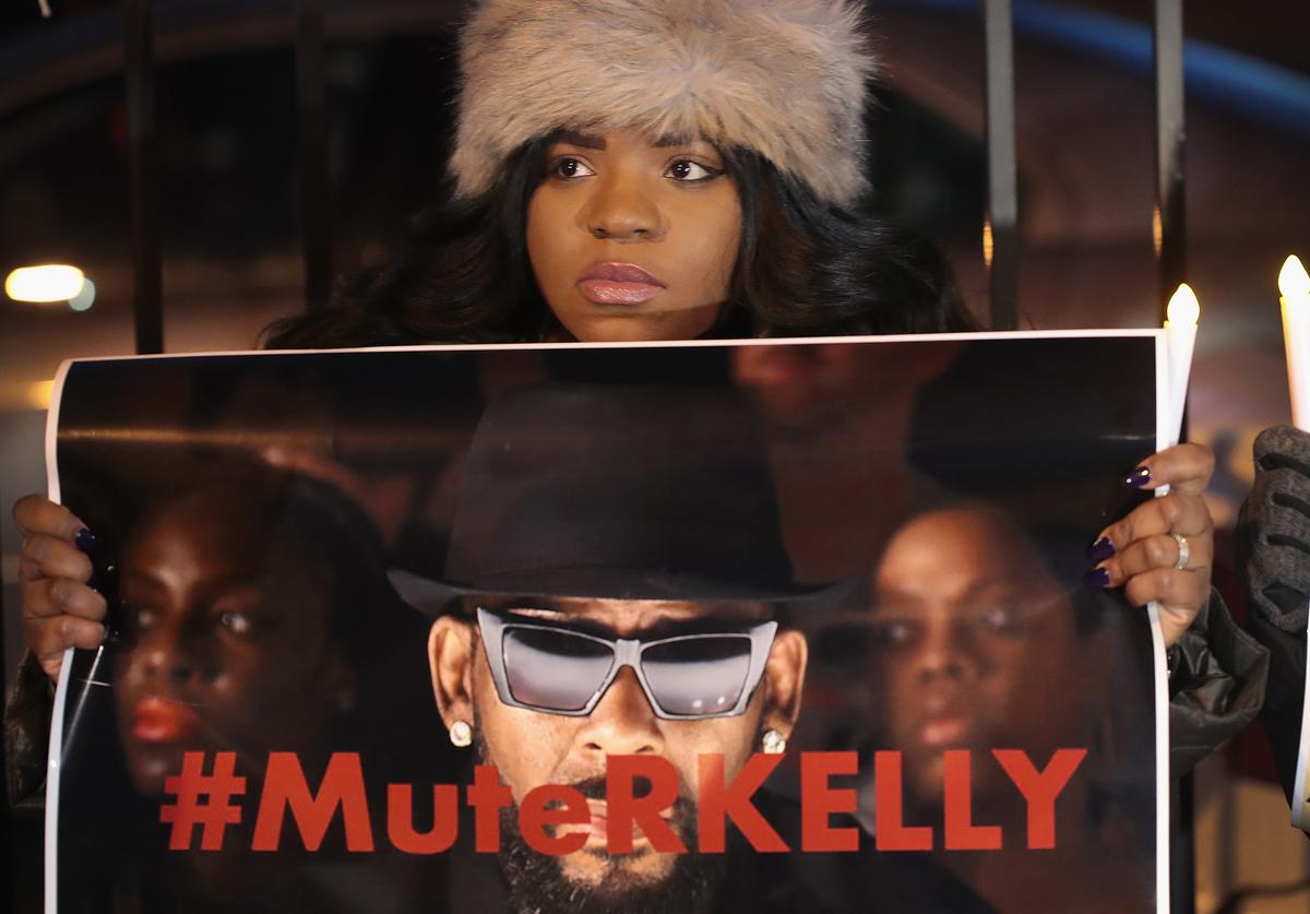 Demonstrators gather near the studio of singer R. Kelly to call for a boycott of his music