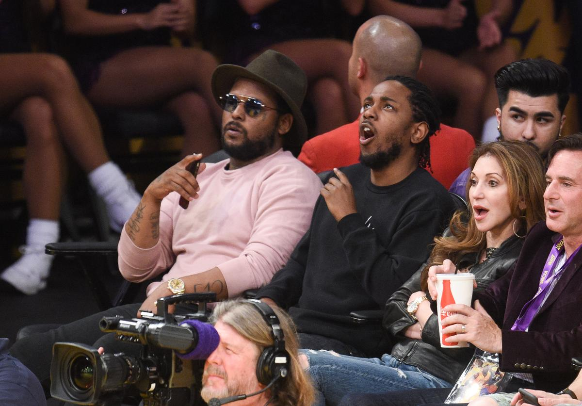 ScHoolboy Q (L) and Kendrick Lamar attend a basketball game between the Utah Jazz and the Los Angeles Lakers at Staples Center on April 13, 2016 in Los Angeles, California