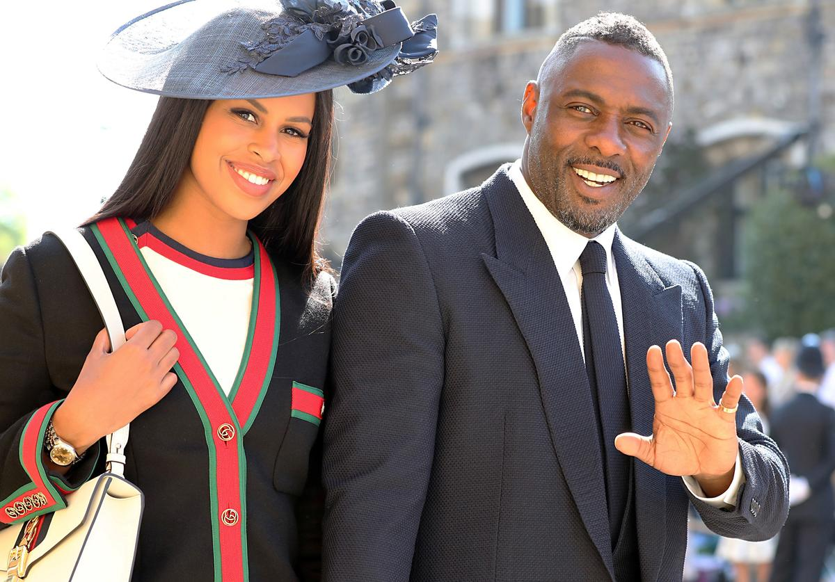 Idris Elba and Sabrina Dhowre arrive at St George's Chapel at Windsor Castle before the wedding of Prince Harry to Meghan Markle on May 19, 2018 in Windsor, England