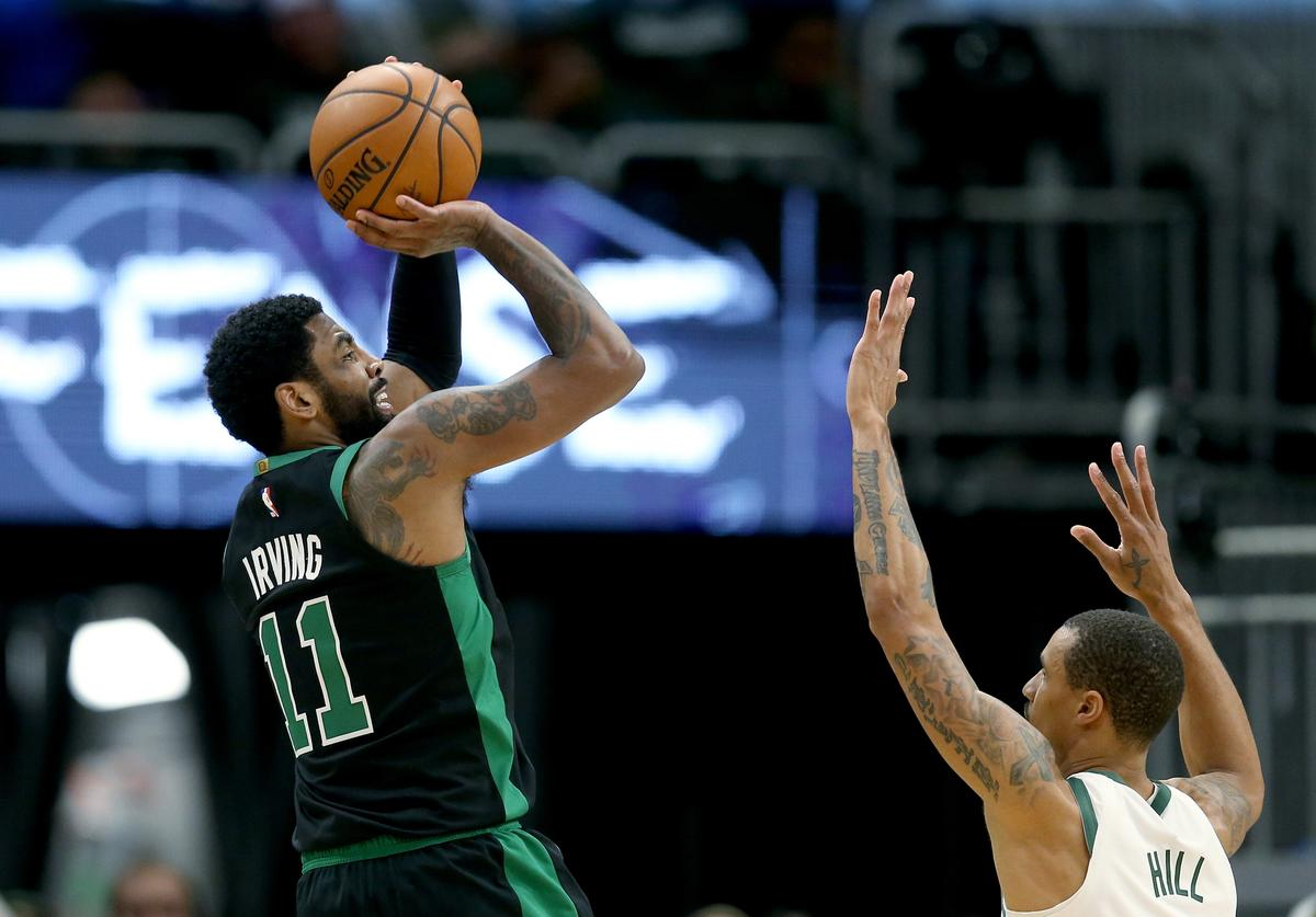 Kyrie Irving #11 of the Boston Celtics attempts a shot while being guarded by George Hill #3 of the Milwaukee Bucks in the fourth quarter during Game One of Round Two of the 2019 NBA Playoffs at the Fiserv Forum on April 28, 2019 in Milwaukee, Wisconsin