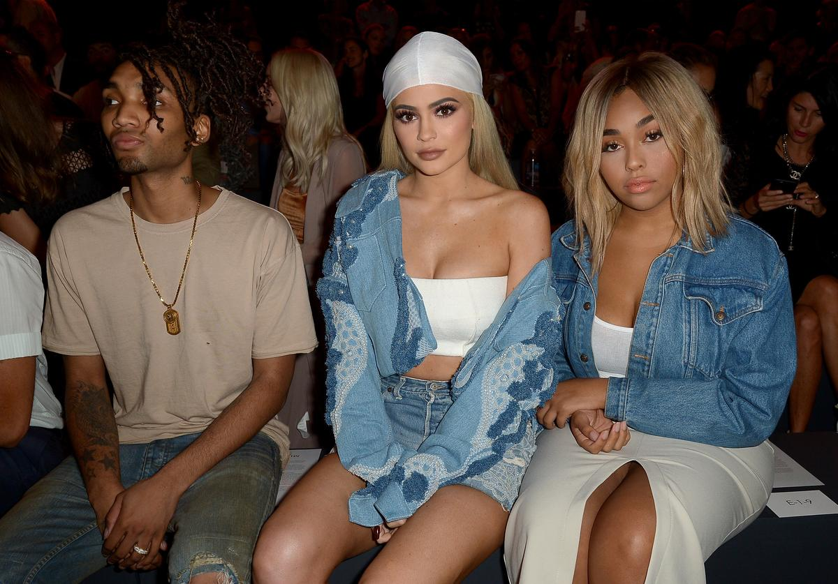 Kylie Jenner (C) and Jordyn Woods (R) attend the Jonathan Simkhai fashion show