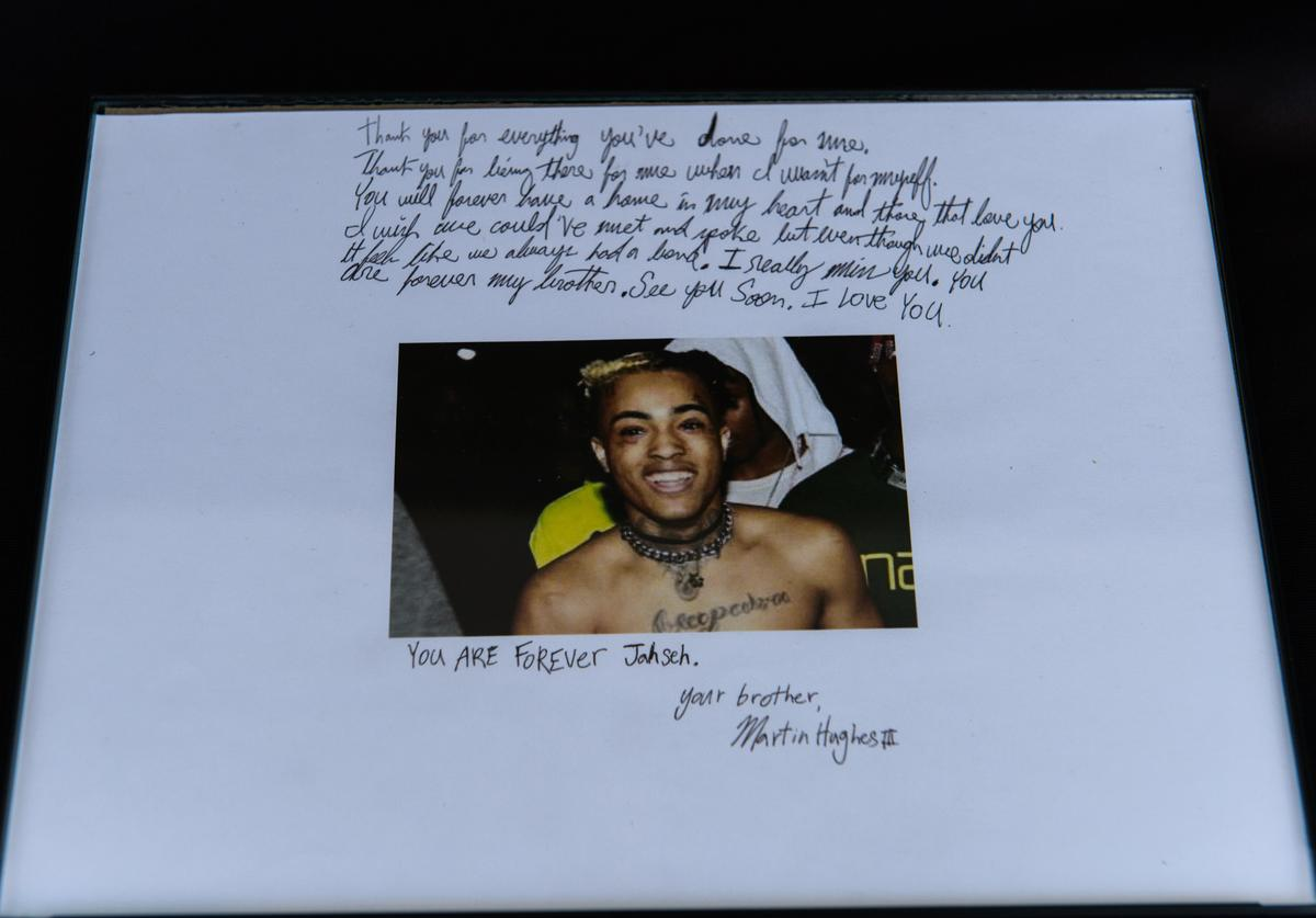 Fans leave art outside the XXXTentacion Funeral & Fan Memorialat BB&T Center on June 27, 2018 in Sunrise, Florida