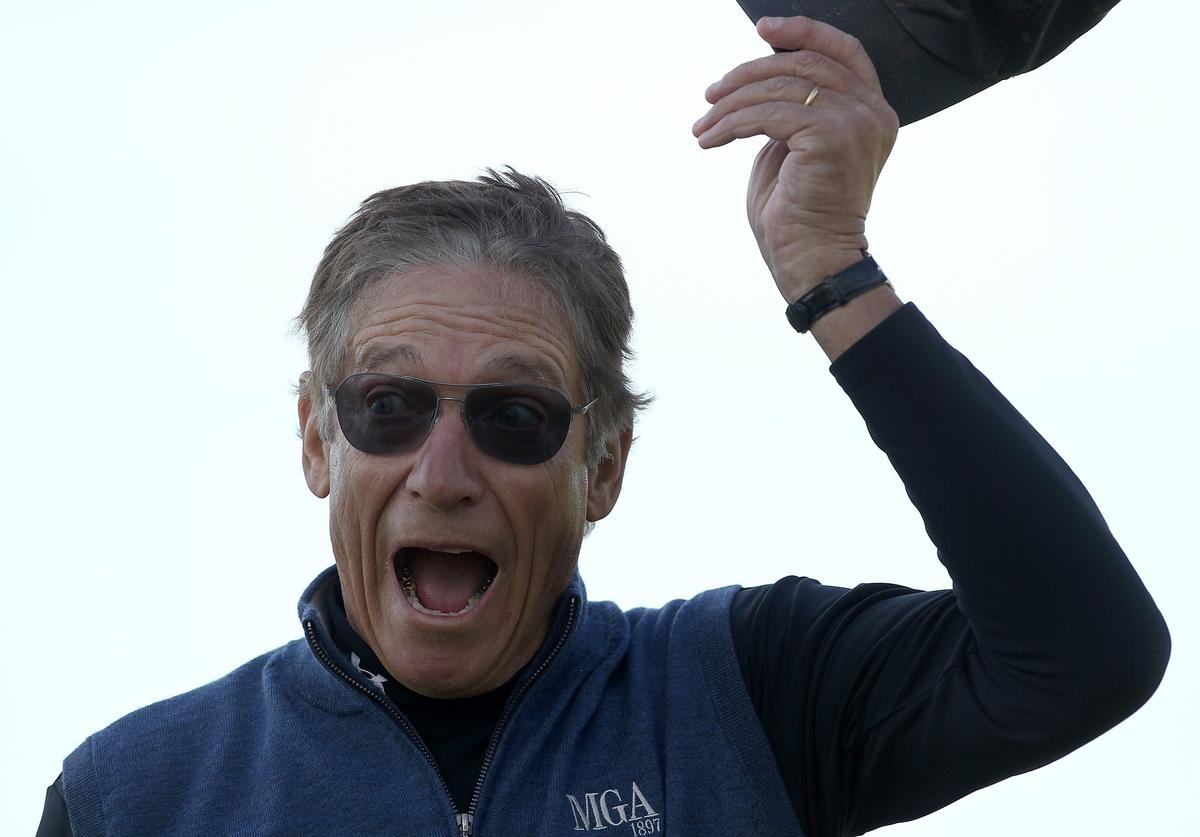 Maury Povich reacts to making a putt on the 5th hole during the final round of the AT&T Pebble Beach National Pro-Am at the Pebble Beach Golf Links on February 13, 2011 in Pebble Beach, California.