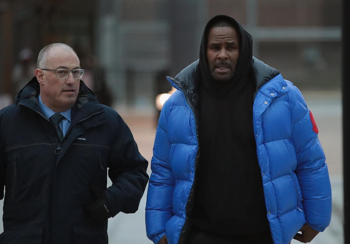 R&B singer R. Kelly (R) and his attorney Steve Greenberg leave Cook County jail after Kelly posted $100 thousand bond on February 25, 2019 in Chicago, Illinois. Kelly was being held after turning himself in to face ten counts of aggravated sexual abuse