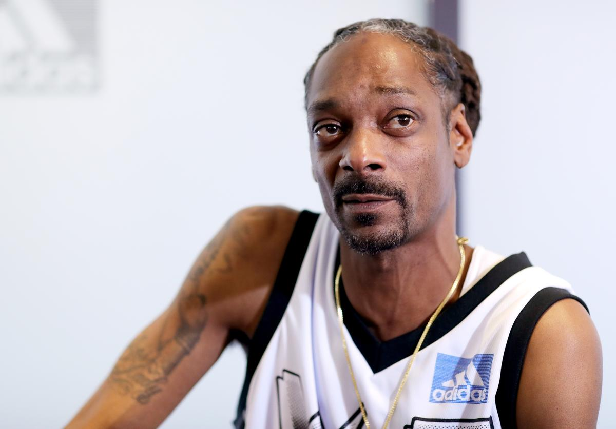 Snoop Dogg speaks during a press conference at adidas Creates 747 Warehouse St., an event in basketball culture, on February 16, 2018 in Los Angeles, California.