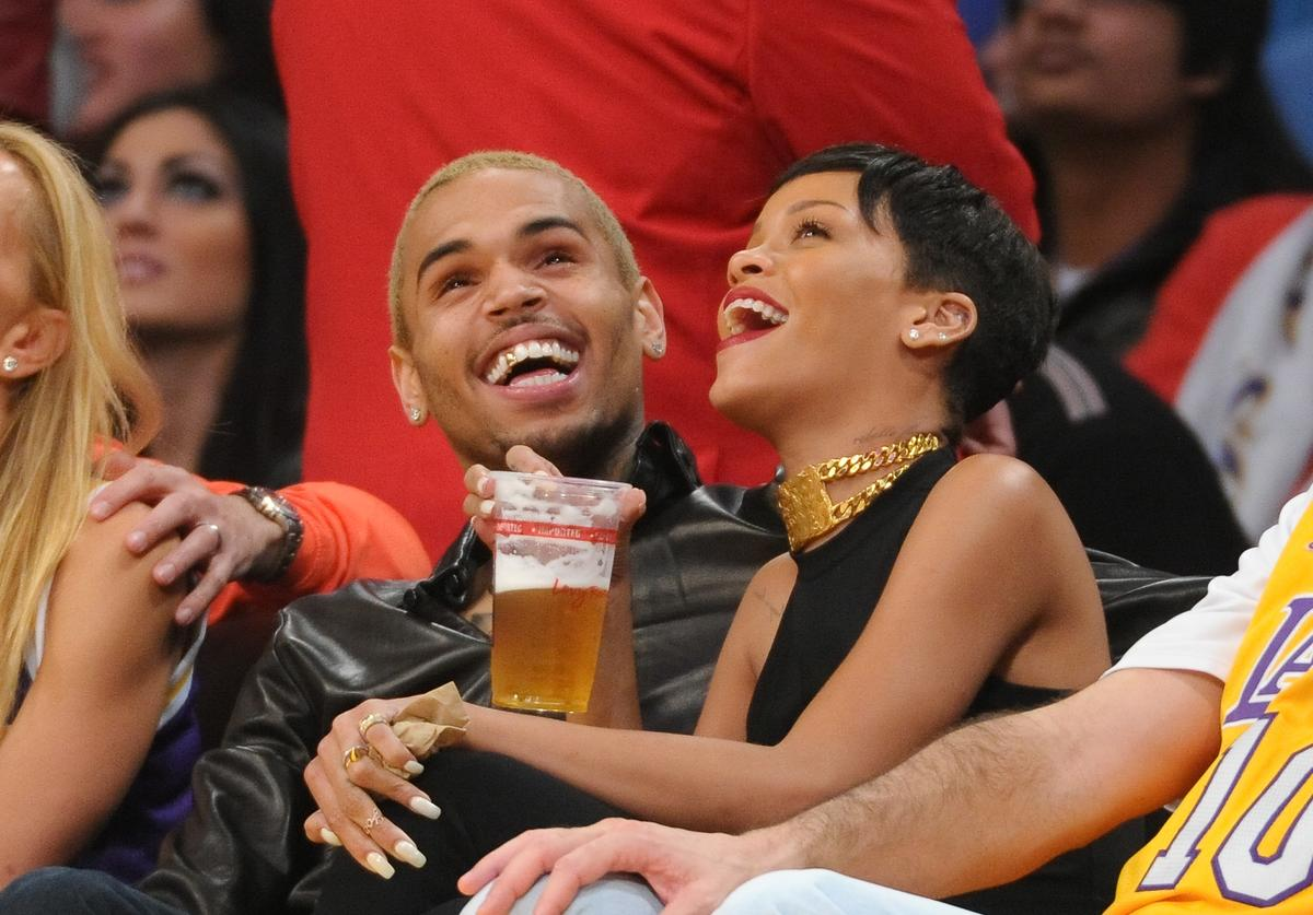 Chris Brown (L) and Rihanna attend a basketball game between the New York Knicks and the Los Angeles Lakers at Staples Center on December 25, 2012 in Los Angeles, California