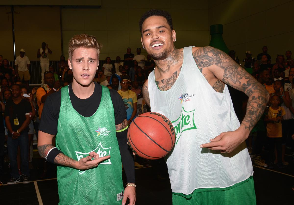 Singers Justin Bieber (L) and Chris Brown attend the Sprite Celebrity Basketball Game during the 2014 BET Experience At L.A. LIVE on June 28, 2014 in Los Angeles, California.