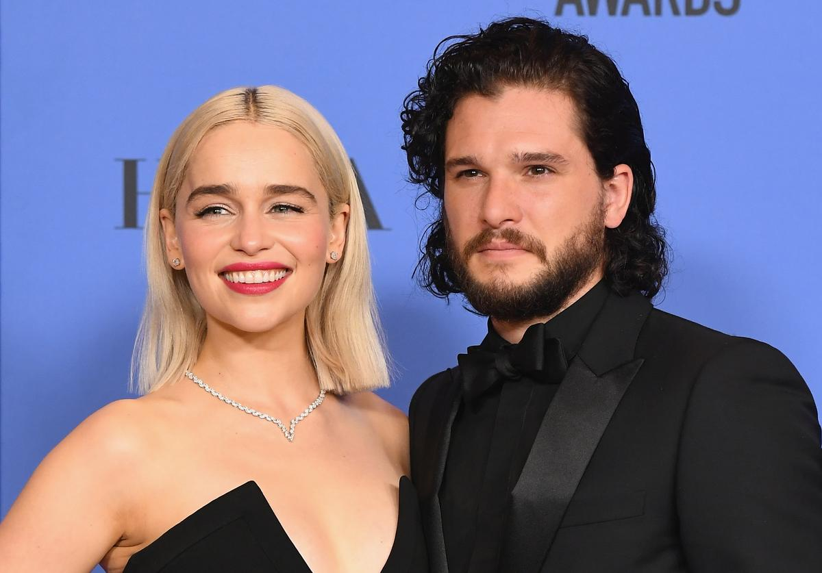 Actors Emilia Clarke and Kit Harington pose in the press room during The 75th Annual Golden Globe Awards