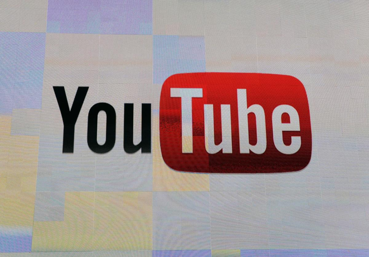 The YouTube logo appears on screen before a keynote address by Vice President of Global Content Partnerships