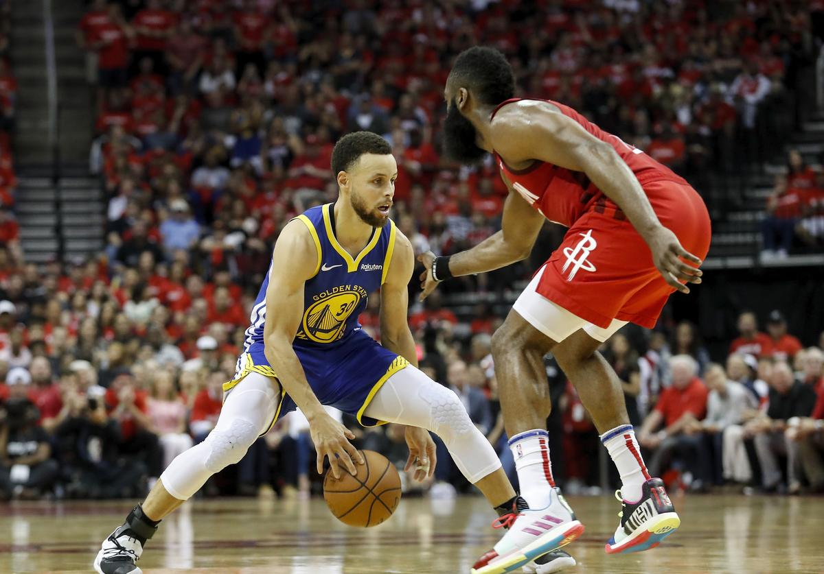 Stephen Curry #30 of the Golden State Warriors dribbles the ball defended by James Harden #13 of the Houston Rockets in the fourth quarter during Game Three of the Second Round of the 2019 NBA Western Conference Playoffs at Toyota Center on May 4, 2019 in Houston, Texas.