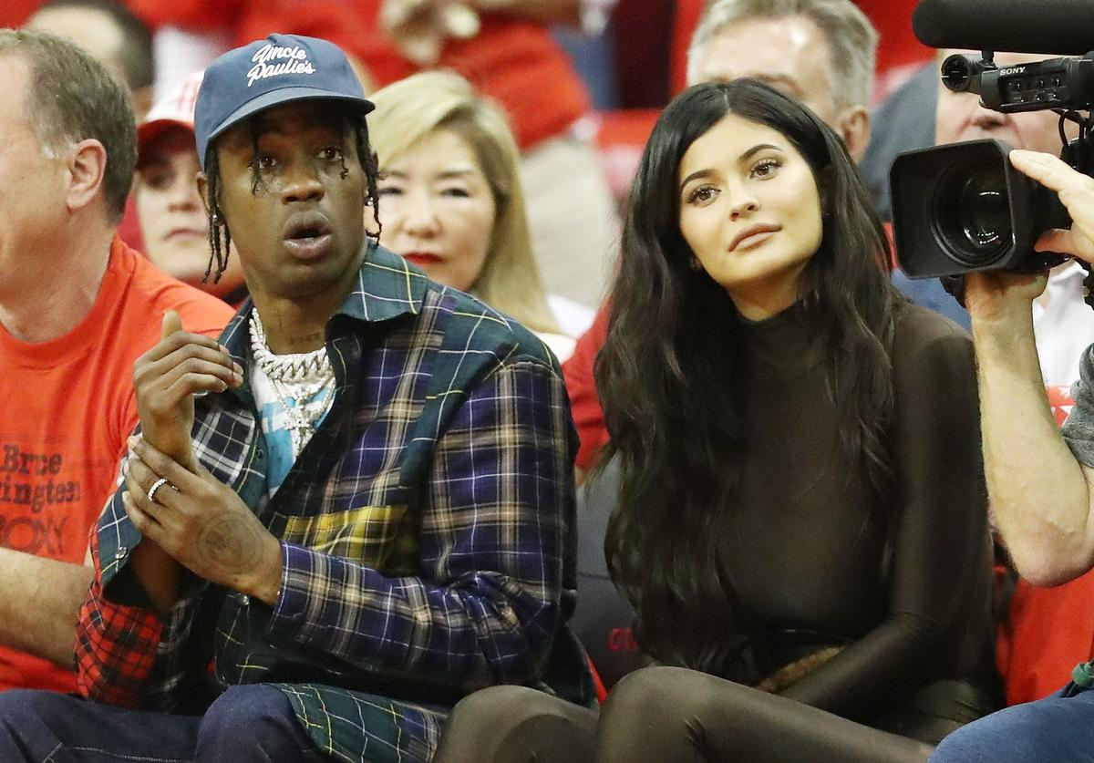 Travis Scott and Kylie Jenner attend Game Seven of the Western Conference Finals