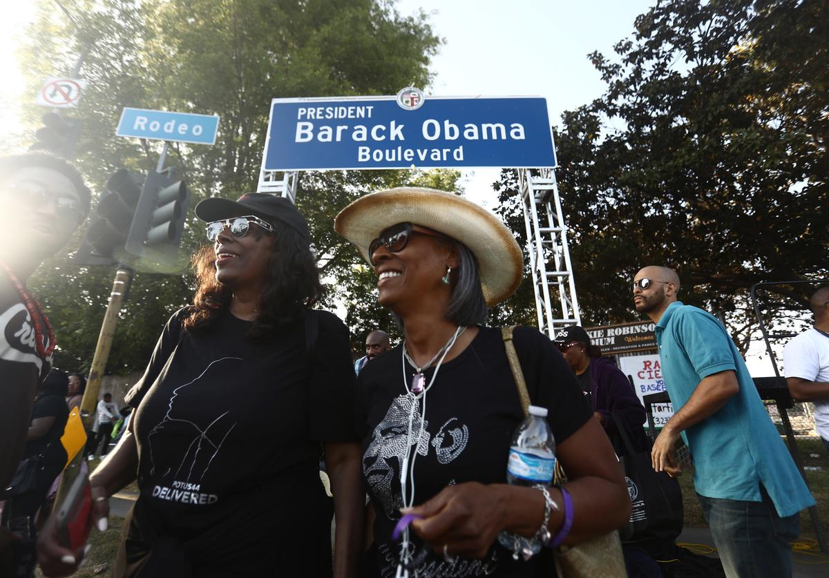 People gather at a festival where a South Los Angeles street was renamed Obama Boulevard