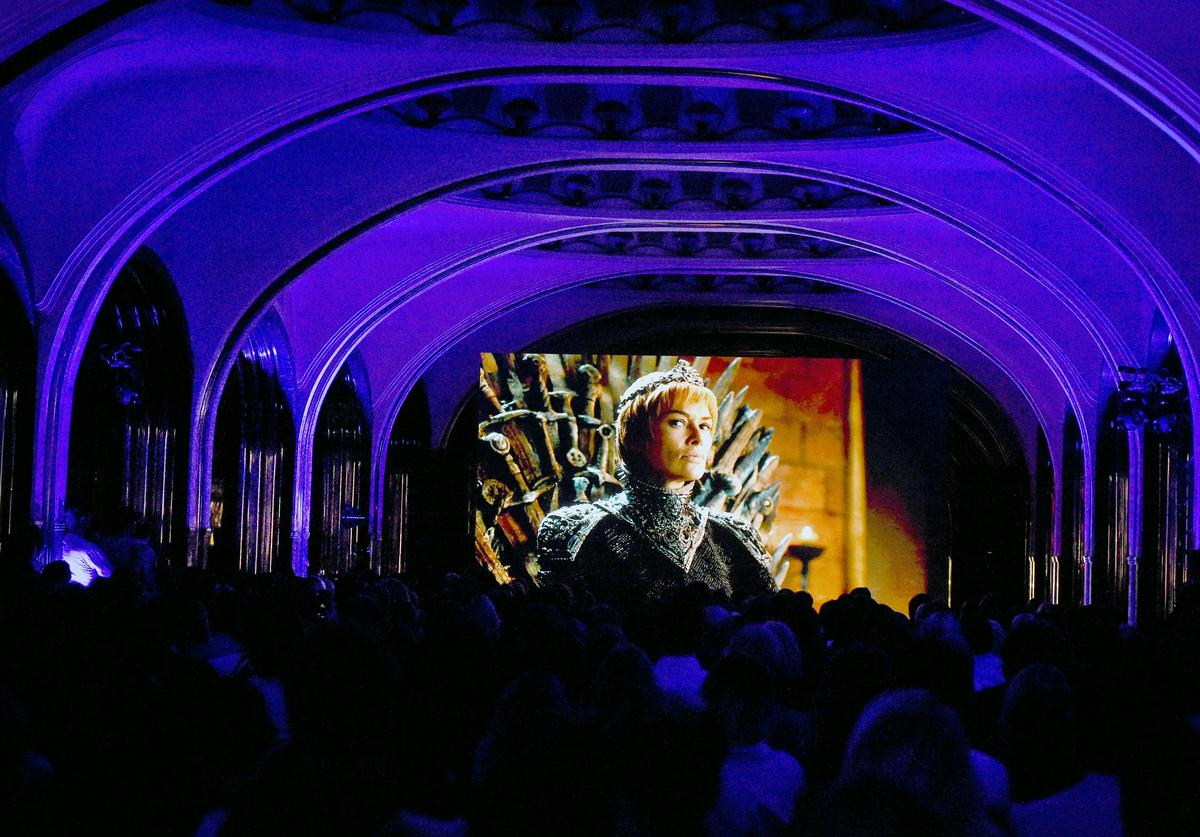 "People watch the seventh season premiere of US TV show ""Game of Thrones"" at the Mayakovskaya metro station in Moscow early on July 18, 2017"