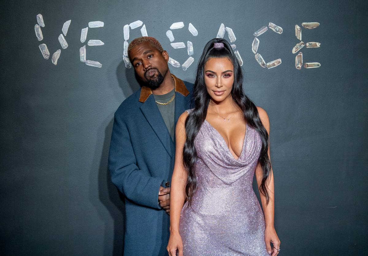 Kanye West and Kim Kardashian West attend the the Versace fall 2019 fashion show at the American Stock Exchange Building in lower Manhattan on December 02, 2018 in New York City