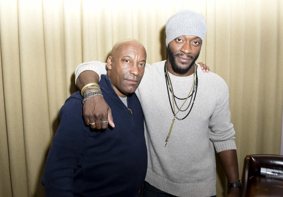 Director John Singleton and actor Aldis Hodge attend the Private Dinner Hosted