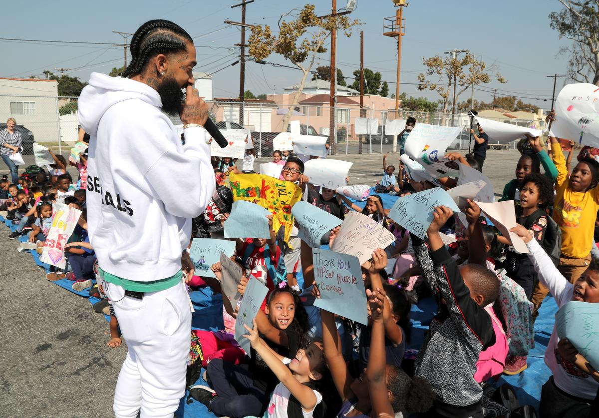 Nipsey Hussle speaks to kids at the Nipsey Hussle x PUMA