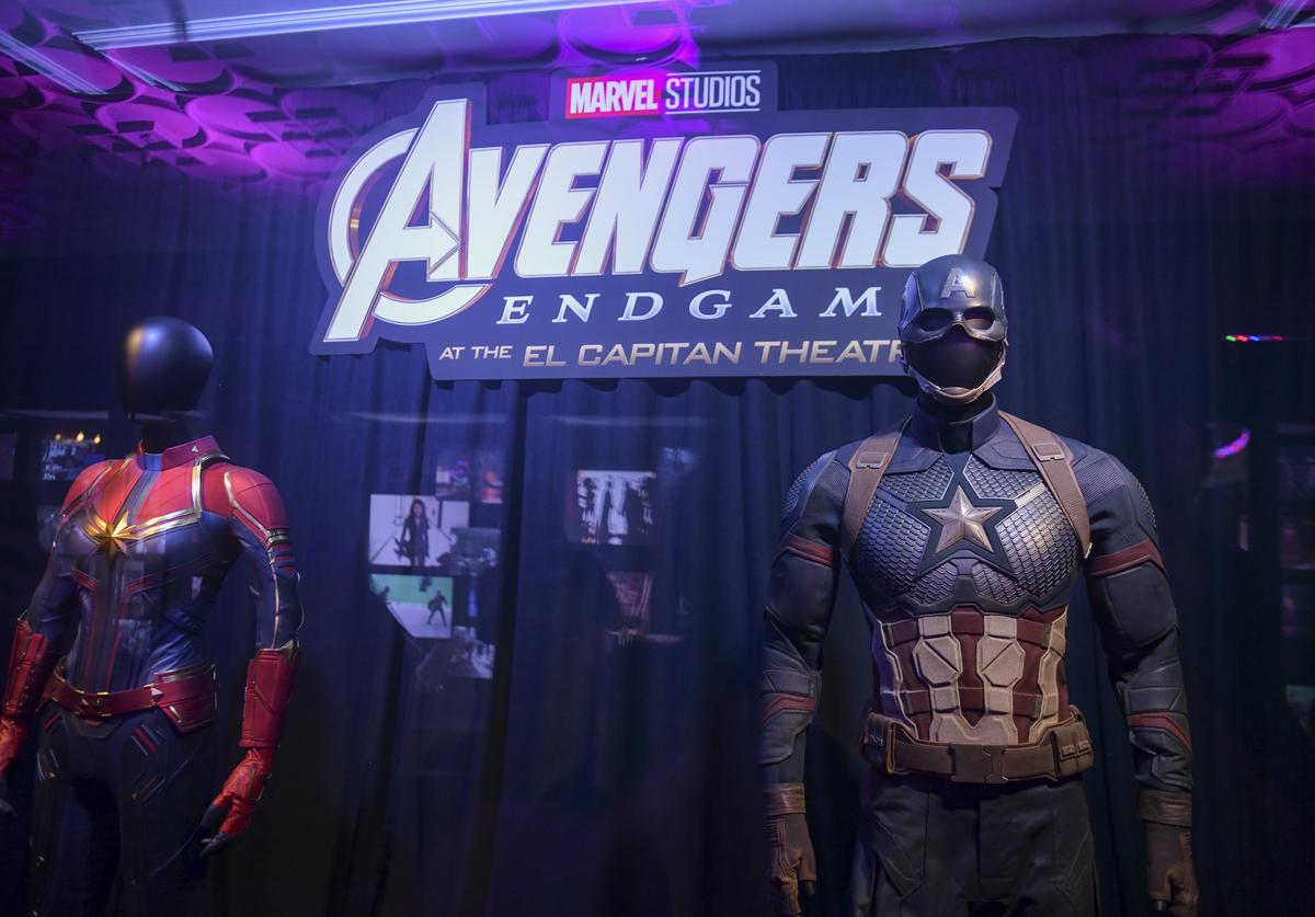 "Captain Marvel's and Captain America's suits on display at the Marvel Studios's ""Avengers: Endgame"" opening day marathon event at El Capitan Theatre on April 25, 2019 in Los Angeles, California"