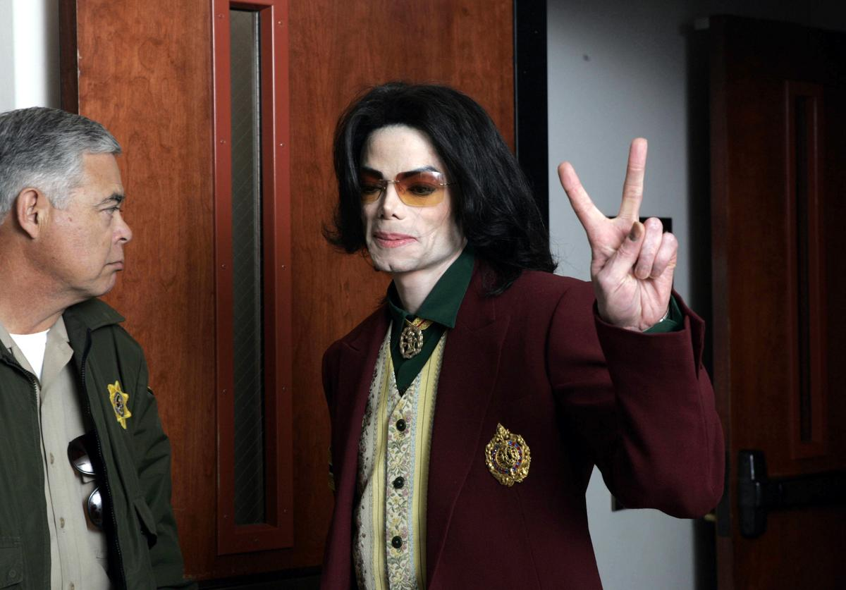 Singer Michael Jackson leaves the courtroom during a break in his child molestation trial