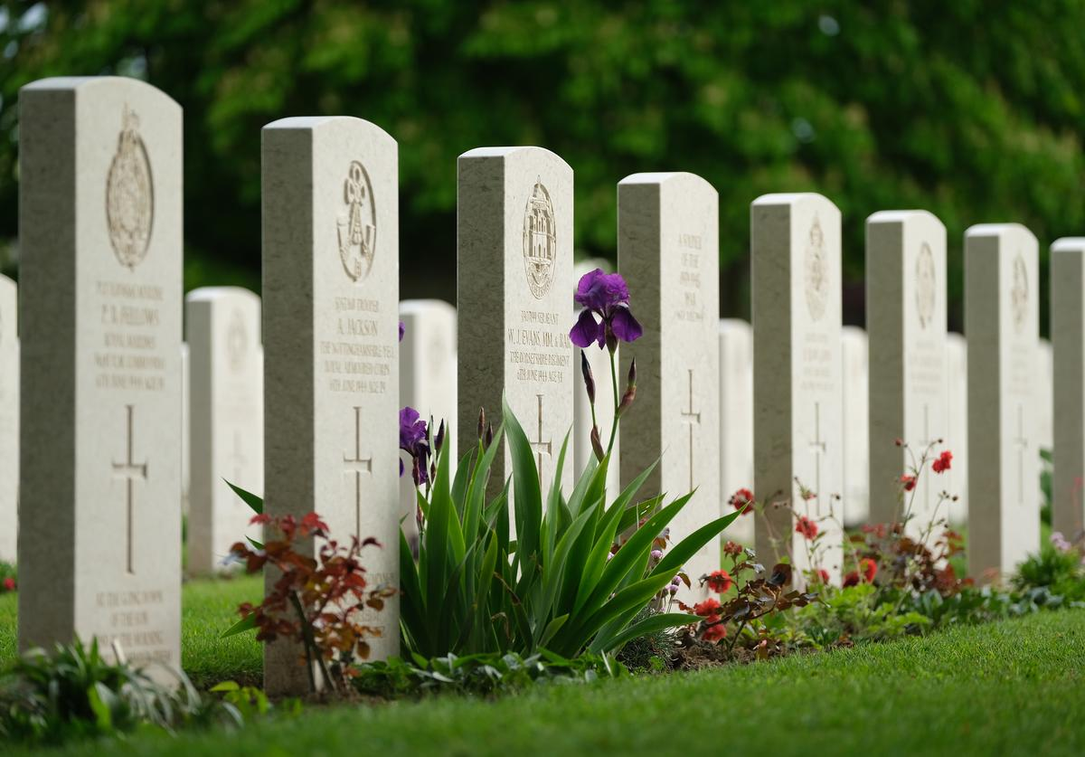 Gravestones stand at the Commonwealth War Graves Commission's Bayeux War Cemetery
