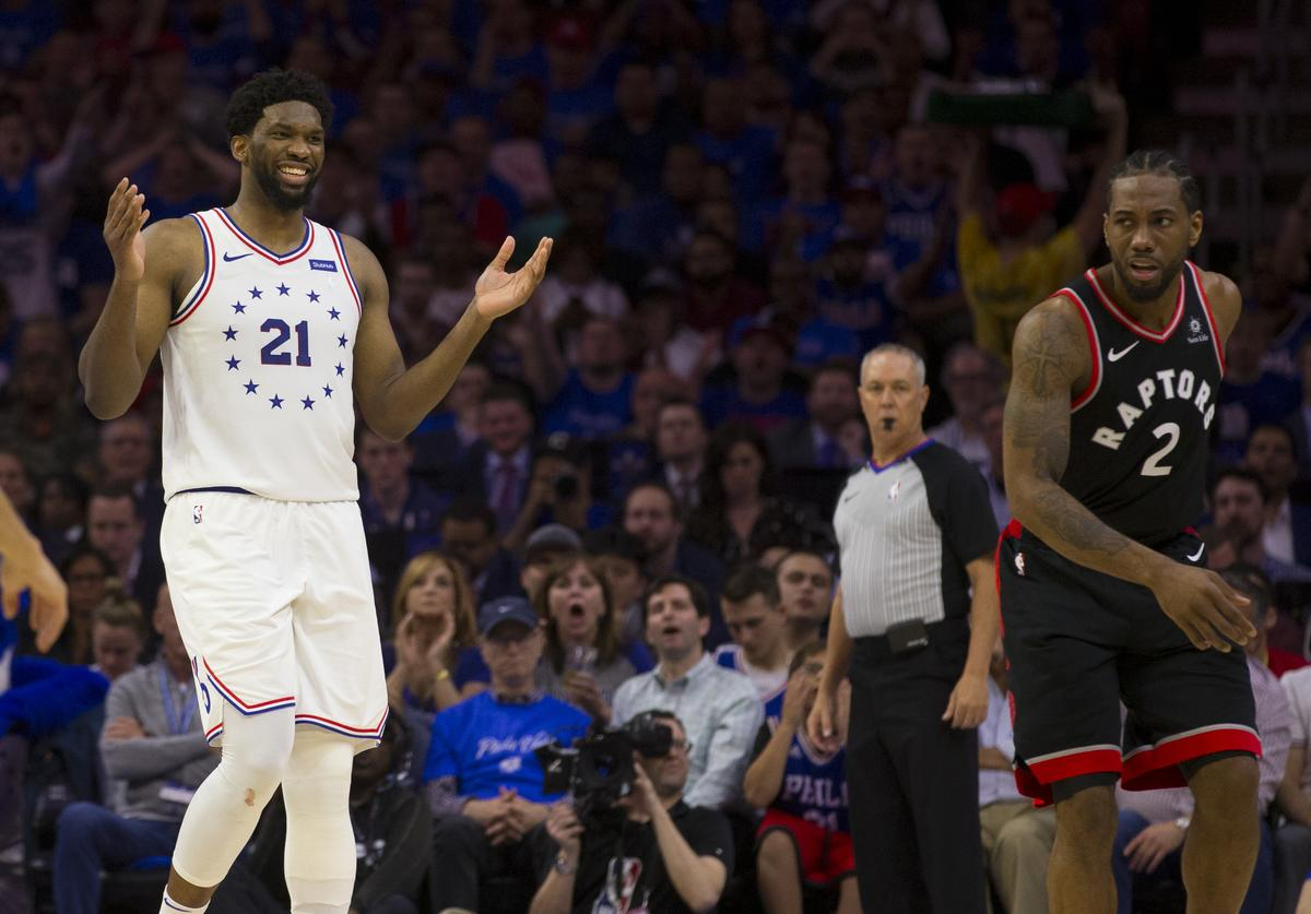 Joel Embiid #21 of the Philadelphia 76ers reacts in front of Kawhi Leonard #2 of the Toronto Raptors in Game Three of the Eastern Conference Semifinals at the Wells Fargo Center on May 2, 2019 in Philadelphia, Pennsylvania