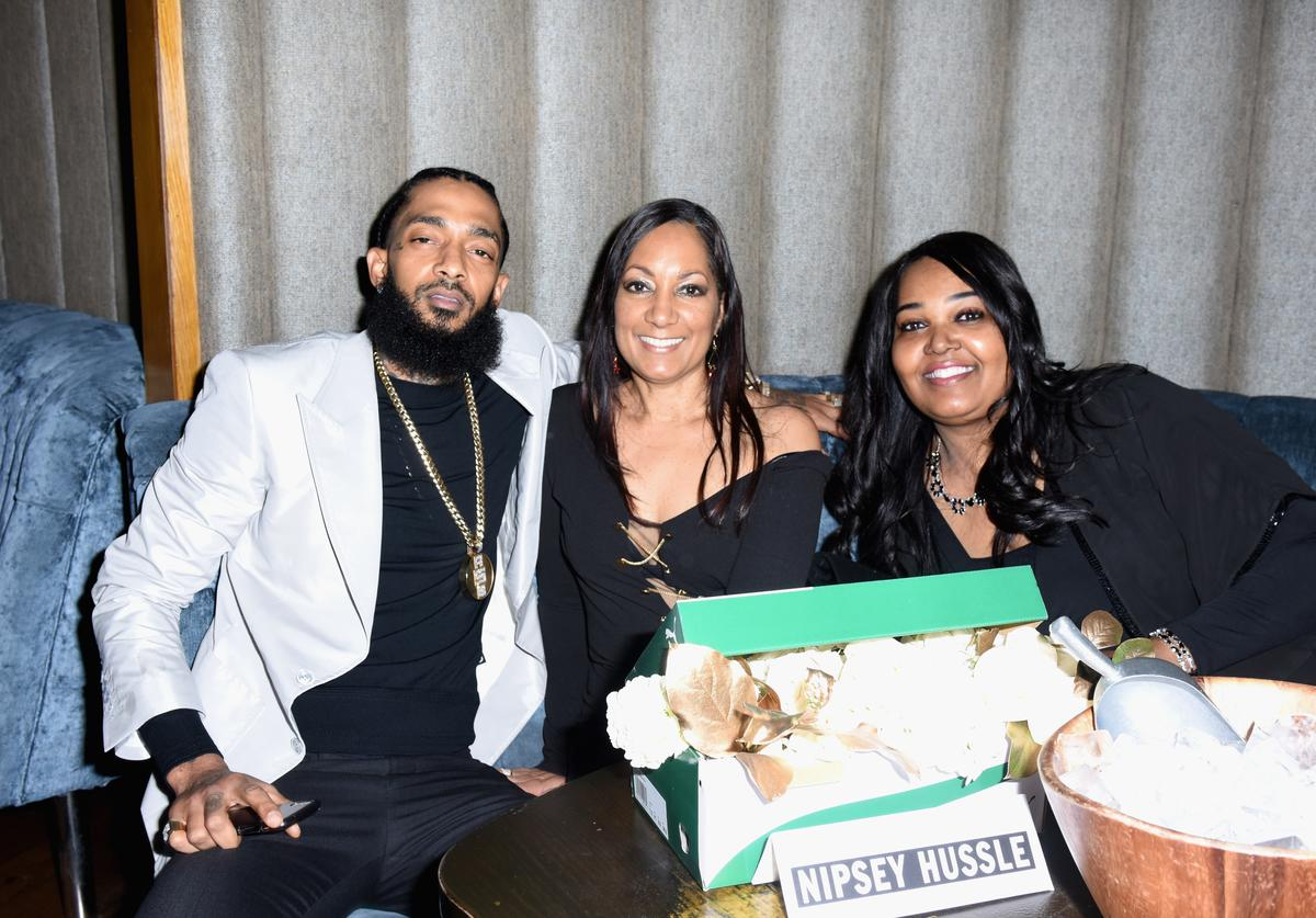 Nipsey Hussle (L), his mother, and his aunt