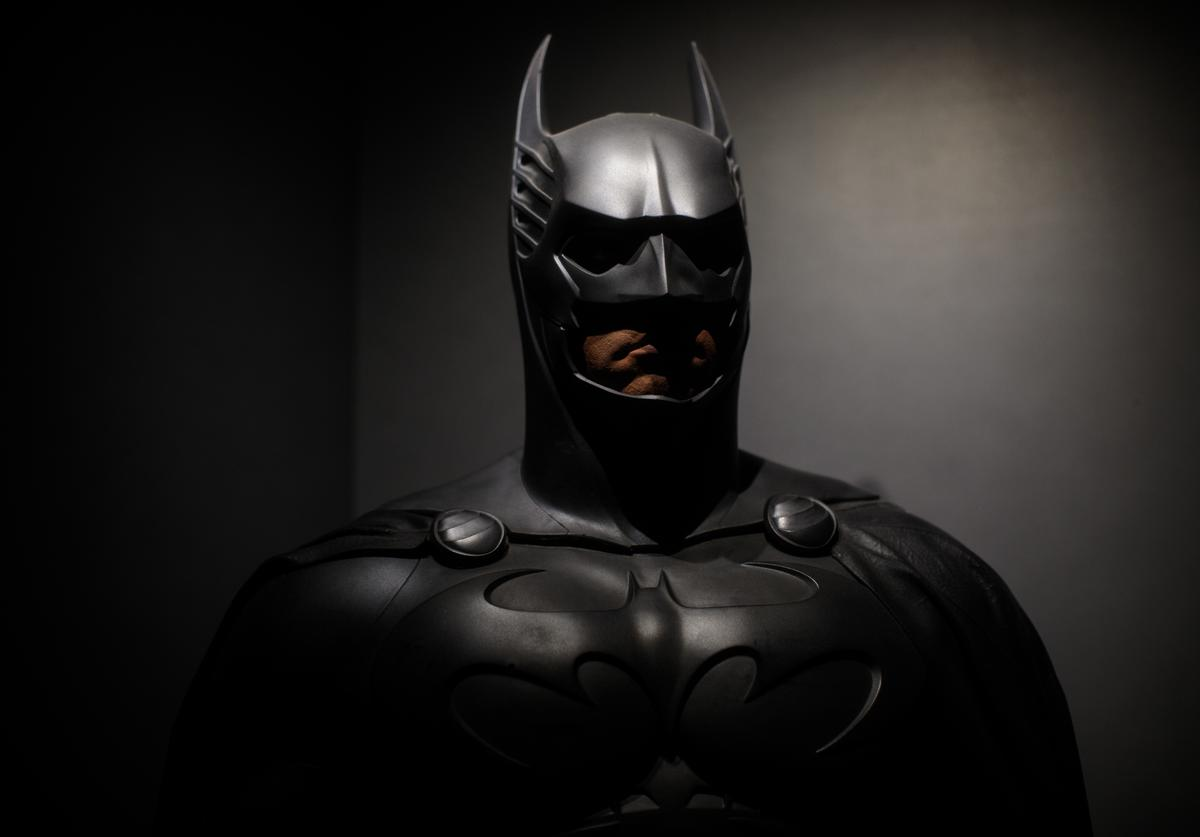 A Batman costume from the 1995 Batman Forever film worn by Val Kilmer and designed by Rob Ringwood and Ingrid Ferrin is on display at the DC Comics Exhibition: Dawn Of Super Heroes at the O2 Arena on February 22, 2018 in London, England