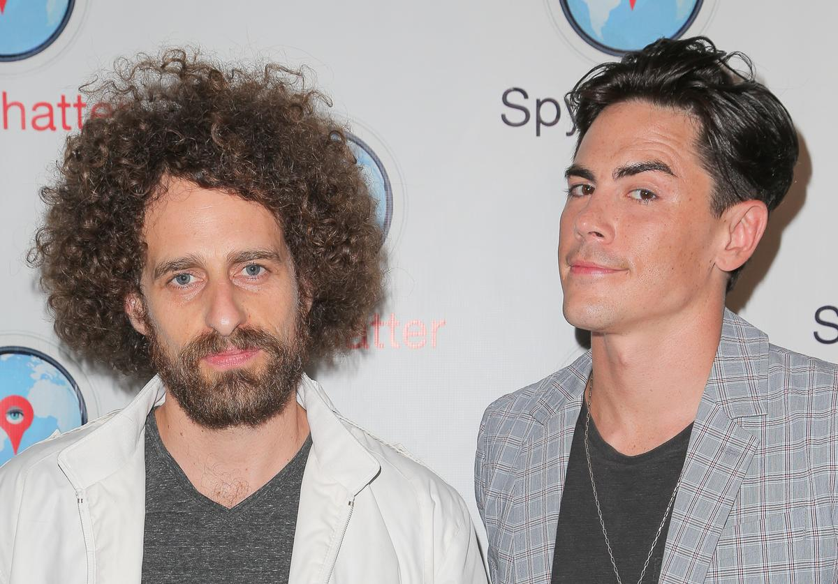 Isaac Kappy (L) and TV personality Tom Sandoval arrive at the Spychatter app launch party at The Argyle on June 30, 2015 in Hollywood, California