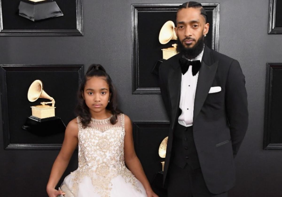 Nipsey Hussle (R) and guest attends the 61st Annual GRAMMY Awards at Staples Center on February 10, 2019 in Los Angeles, California