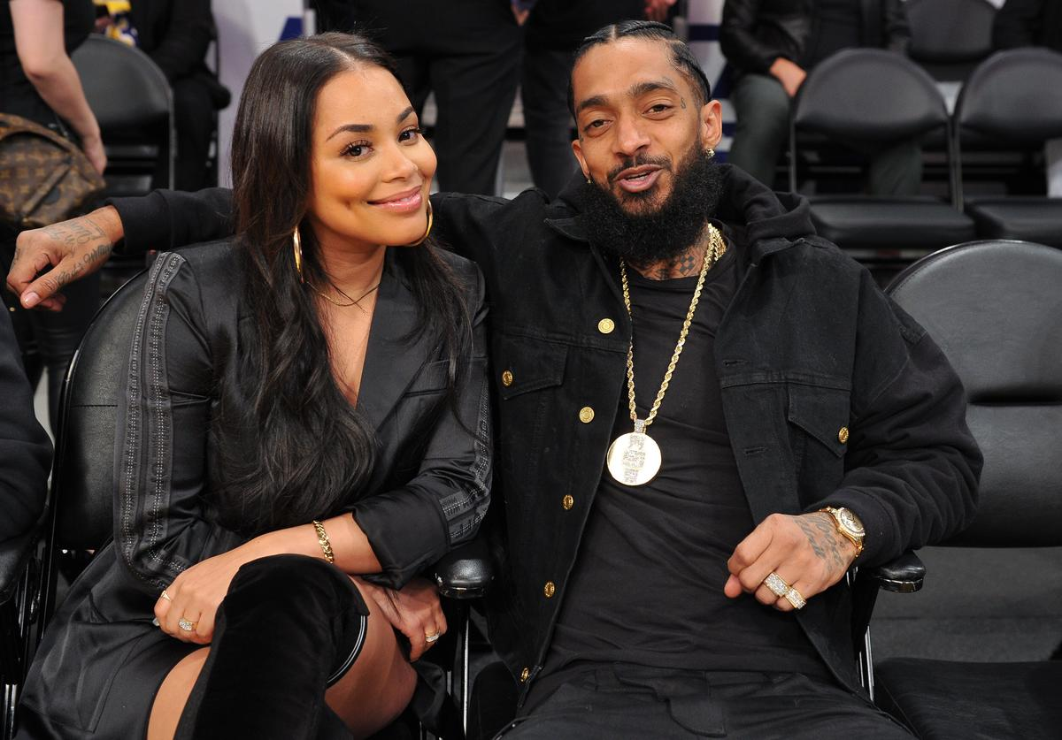 Nipsey Hussle and Lauren London attend a basketball game between the Los Angeles Lakers and the Portland Trail Blazers at Staples Center on November 14, 2018 in Los Angeles, California