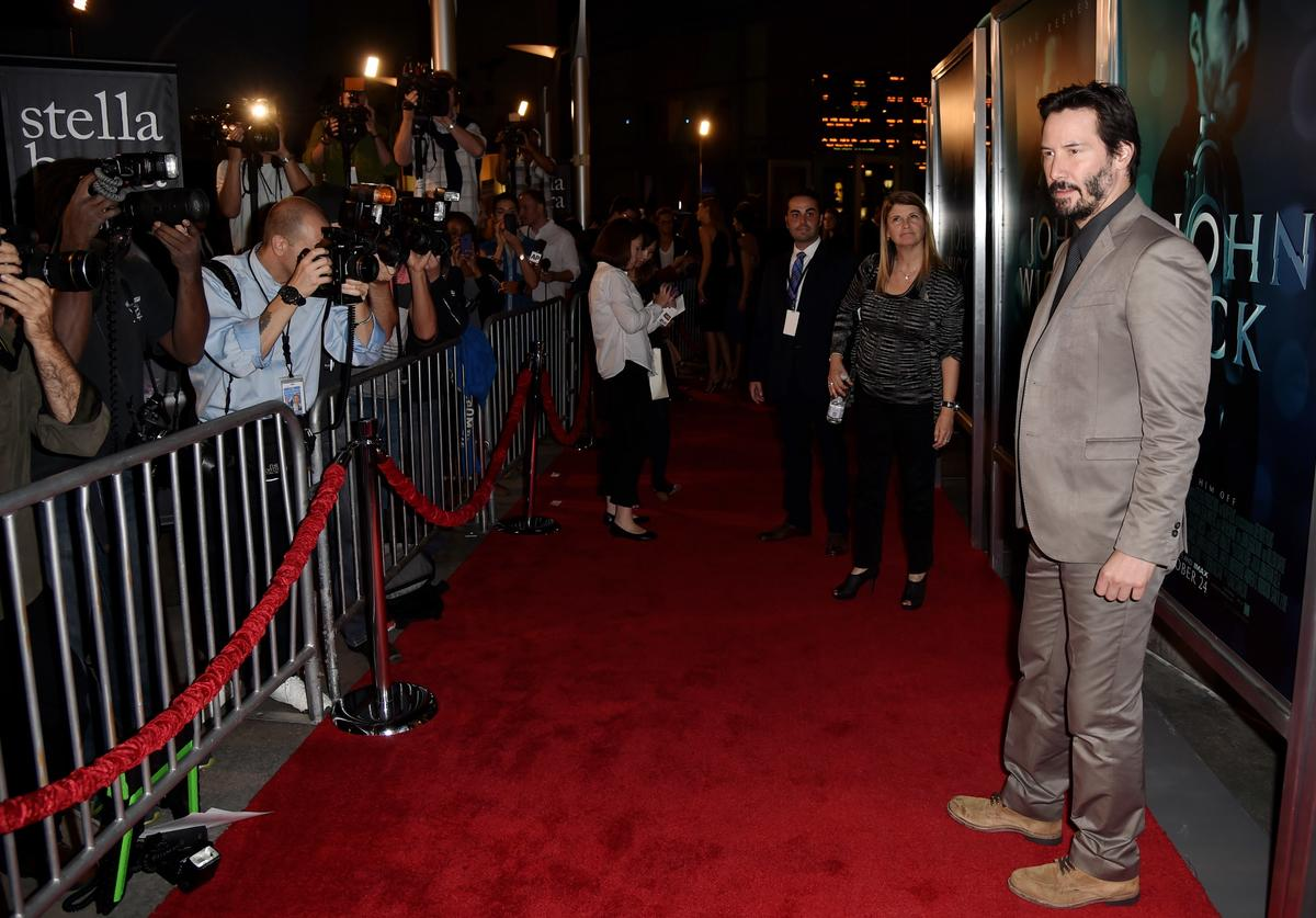 "Actor Keanu Reeves arrives at a screening of Lionsgate Films' ""John Wick"""