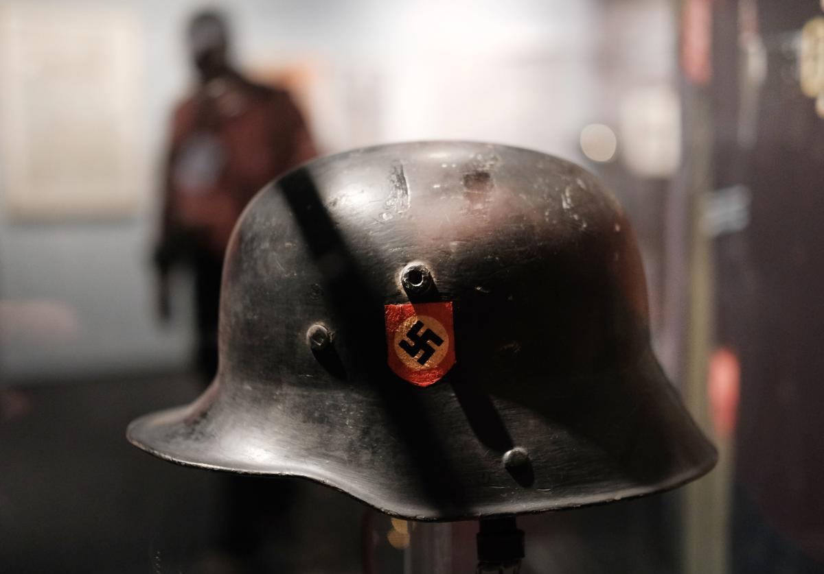 A German helmet with a swastika is displayed in the new exhibition at the Museum of Jewish Heritage