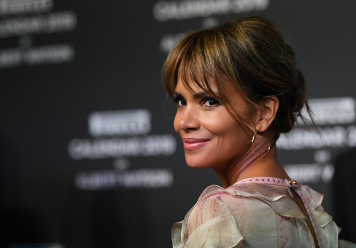 Halle Berry walks the red carpet ahead of the 2019 Pirelli Calendar launch gala at HangarBicocca on December 5, 2018 in Milan, Italy.