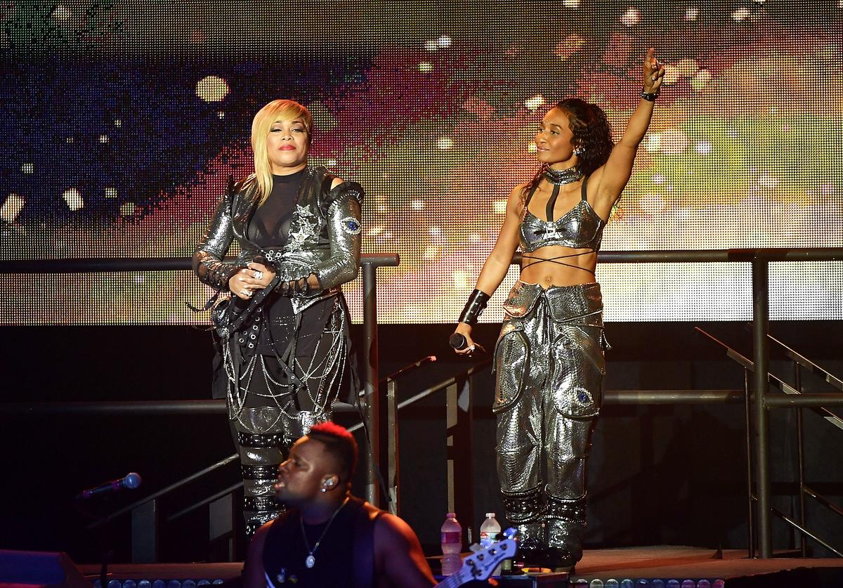 Tionne 'T-Boz' Watkins (L) and Rozonda 'Chilli' Thomas of the music group 'TLC' perform onstage