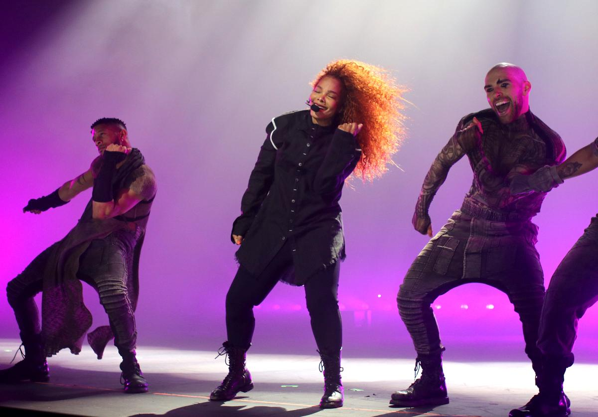 Janet Jackson (C) performs onstage during the opening night of her Metamorphosis - The Las Vegas Residency
