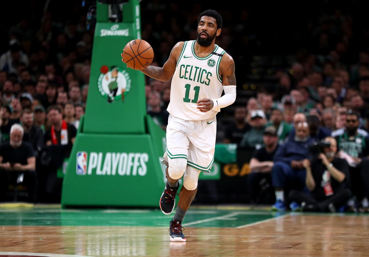 Kyrie Irving #11 of the Boston Celtics dribbles against the Milwaukee Bucks during the second quarter of Game 4 of the Eastern Conference Semifinals during the 2019 NBA Playoffs at TD Garden on May 06, 2019 in Boston, Massachusetts.