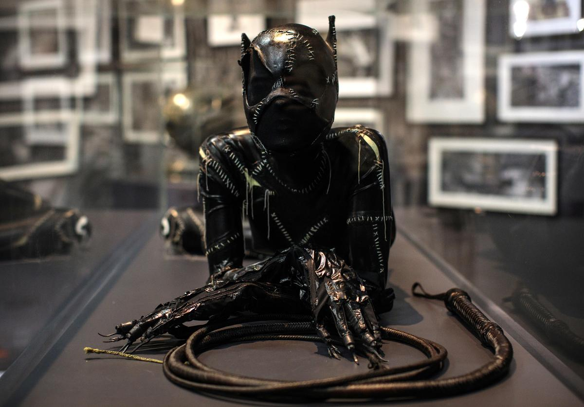 A Catwoman costume from the 1992 Batman Returns film worn by Michelle Pfeiffer and designed by Rob Ringwood and Mary Vogt is on display at the DC Comics Exhibition: Dawn Of Super Heroes at the O2 Arena on February 22, 2018 in London, England.