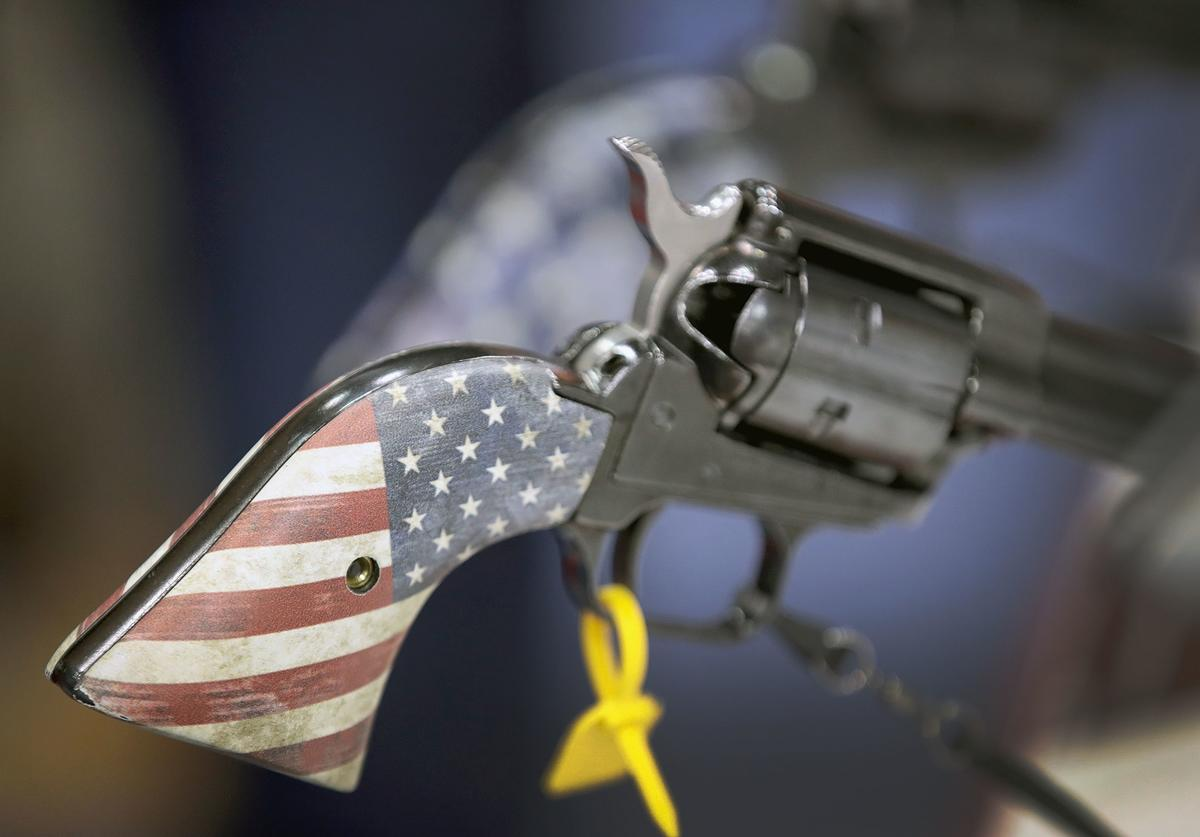 Pistols are displayed in the Heritage Manufacturing booth at the 148th NRA Annual Meetings & Exhibits on April 27, 2019 in Indianapolis, Indiana. The convention, which runs through Sunday, features more than 800 exhibitors and is expected to draw 80,000 guests.