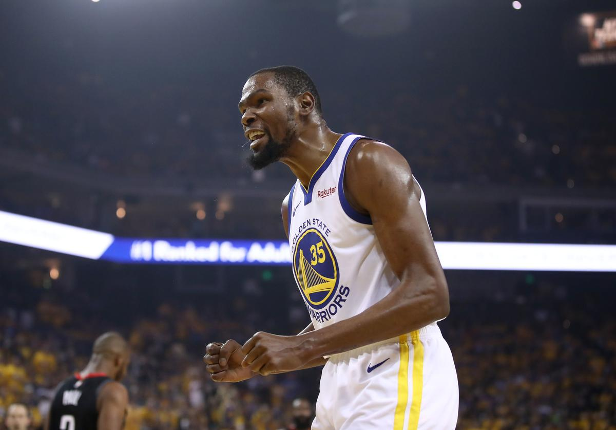Kevin Durant #35 of the Golden State Warriors reacts during their game against the Houston Rockets in Game Five of the Western Conference Semifinals of the 2019 NBA Playoffs at ORACLE Arena on May 08, 2019 in Oakland, California. NOTE TO USER: User expressly acknowledges and agrees that, by downloading and or using this photograph, User is consenting to the terms and conditions of the Getty Images License Agreement.