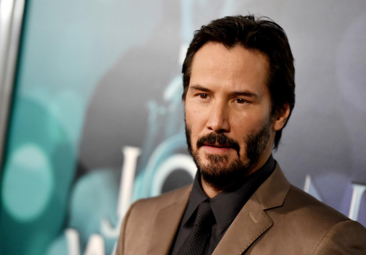 "ctor Keanu Reeves arrives at a screening of Lionsgate Films' ""John Wick"""