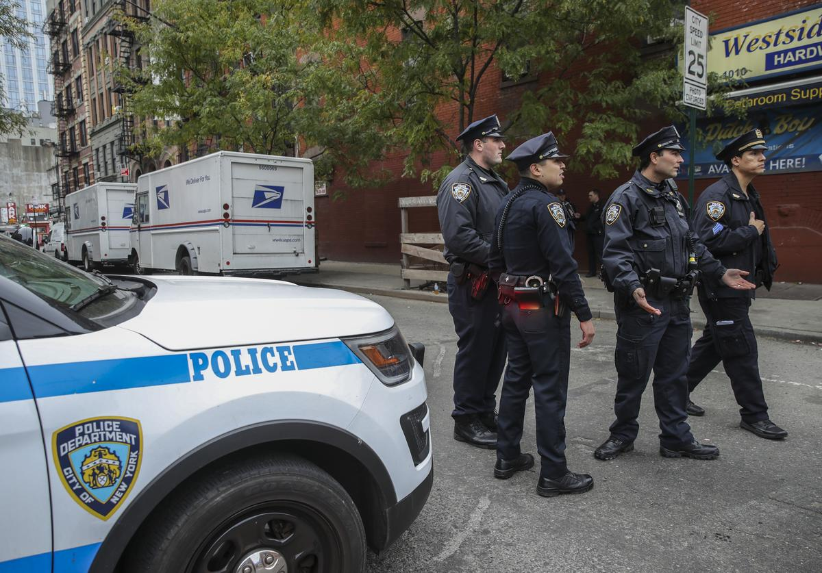 Law enforcement officials respond to a suspicious package at a U.S. Post Office