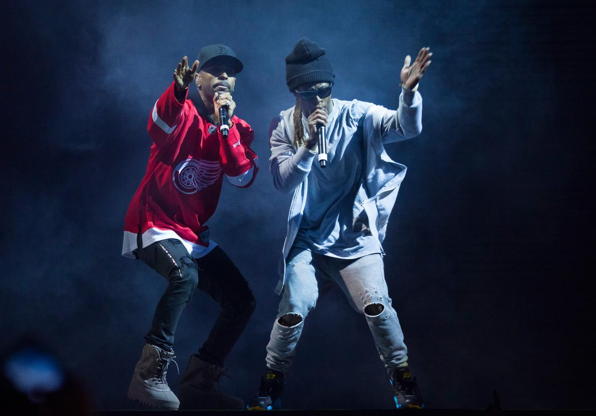 Big Sean (L) and with special guest Lil Wayne perform in concert in his hometown of Detroit at Joe Louis Arena on November 6, 2015 in Detroit, Michigan