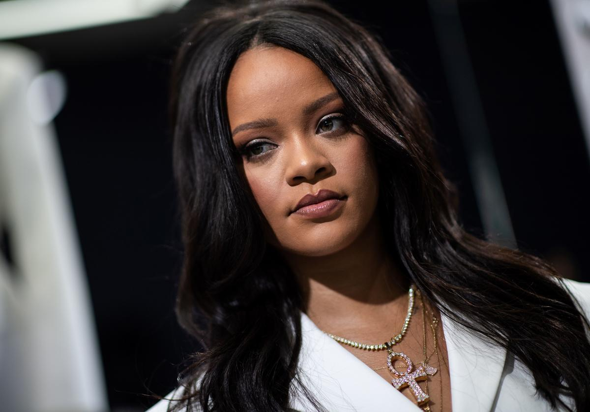 Rihanna poses during a promotionnal event of her brand Fenty in Paris on May 22, 2019.