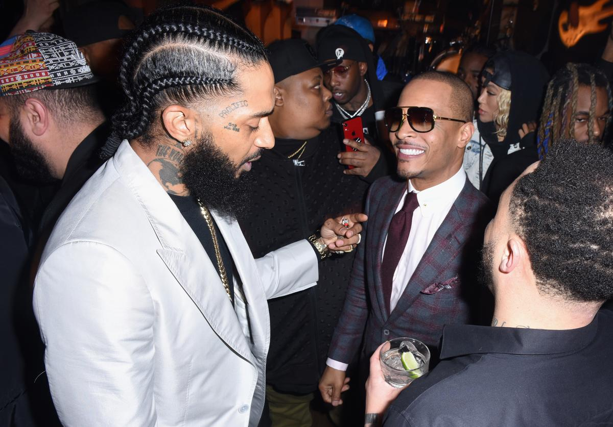 Nipsey Hussle (L) and T.I. attend the PUMA x Nipsey Hussle 2019 Grammy Nomination Party at The Peppermint Club on January 16, 2019 in Los Angeles, California