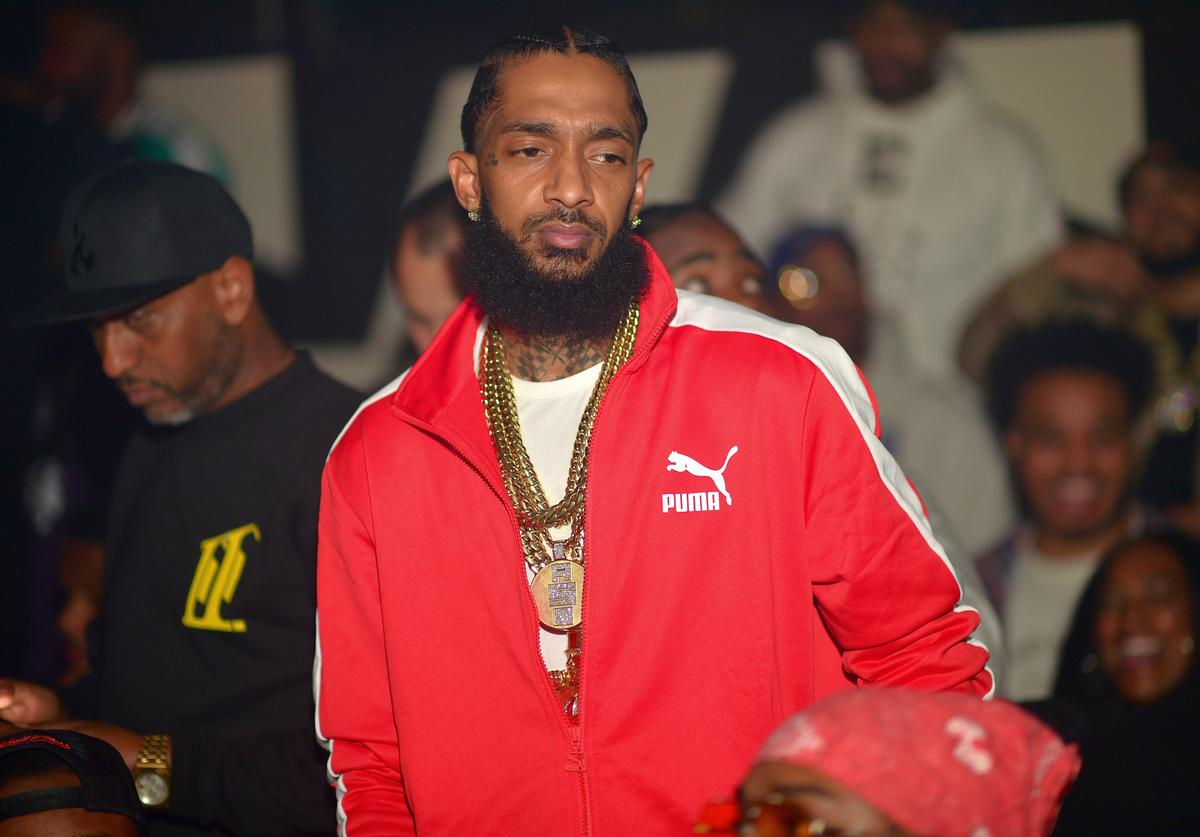 Alex Gidewon and Nipsey Hussle attend a Party at Gold Room on April 7, 2018 in Atlanta, Georgia