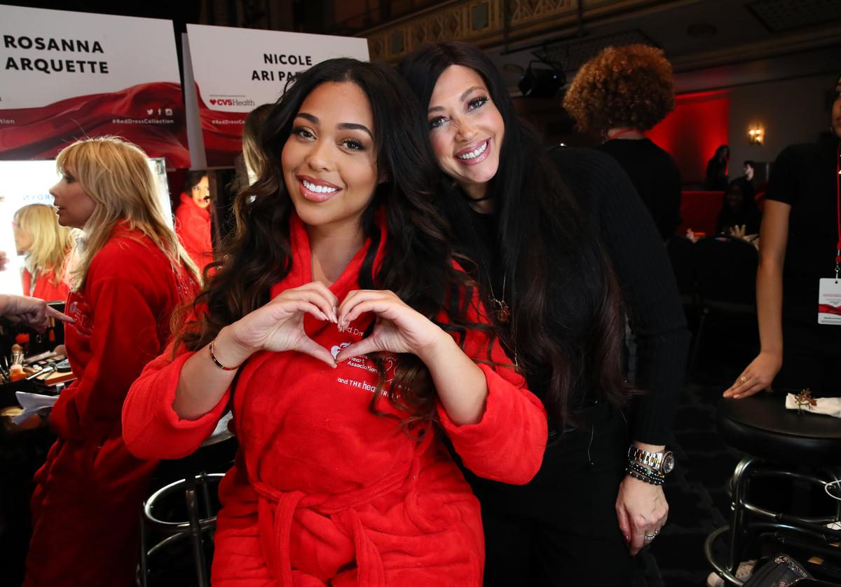 : Jordyn Woods and Elizabeth Woods pose backstage during The American Heart Association's Go Red for Women